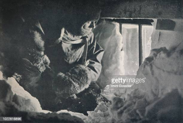 Clearing Drift from Window of Hut at Cape Adare' circa 1911 The final expedition of British Antarctic explorer Captain Robert Falcon Scott left...