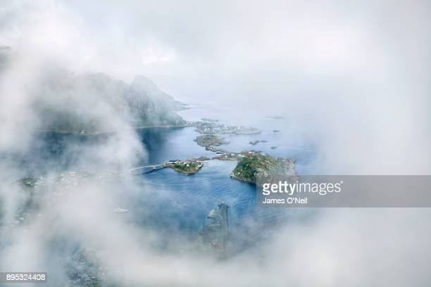 Clearing in clouds showing the fishing village Reine, Lofoten, Norway