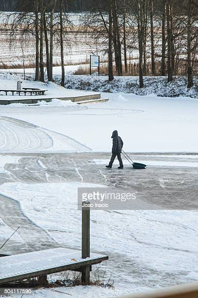 Clearing snow off an outdoor ice rink