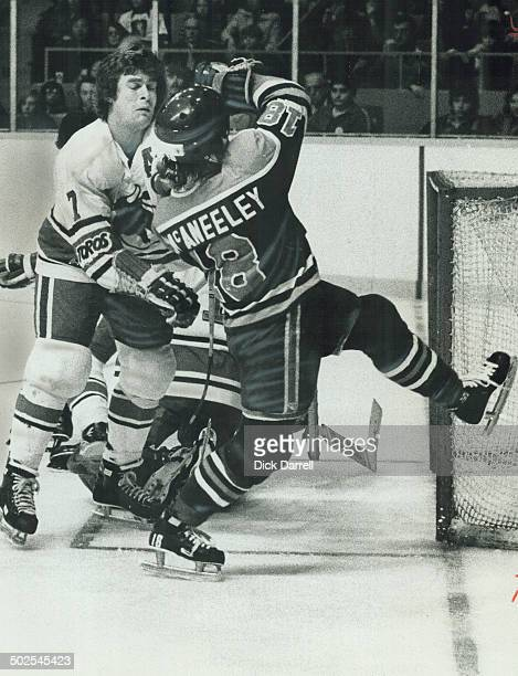 Clearing The Crease Toronto Toros' defenceman Jim Dorey clears Ted McAneeley of Edmonton Oilers from in front of Toronto net during World Hockey...