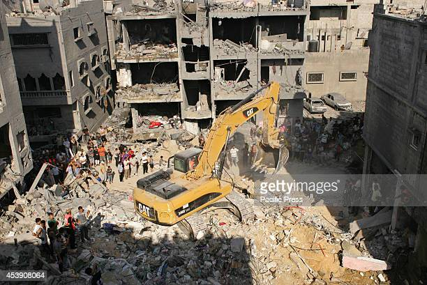 Clearing the remains of a destroyed building, following according to Hamas the killing of three of its senior commanders who were identified as...