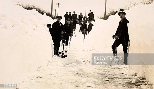 Clearing the snow from the Enstone Road near Chipping Norton in Oxfordshire after the Christmas day snowfall on 25th December 1917