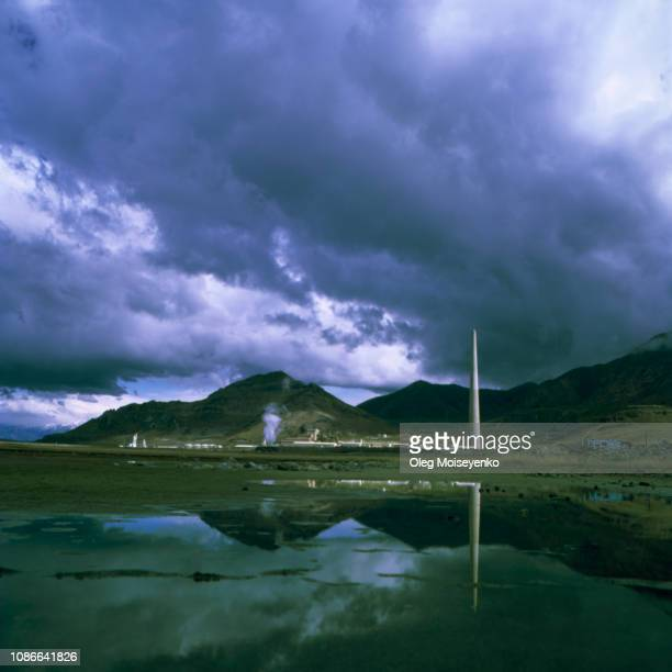 clearing thunderstorm clouds atop of kennecott utah copper's garfield smelter stack - acid rain stock pictures, royalty-free photos & images