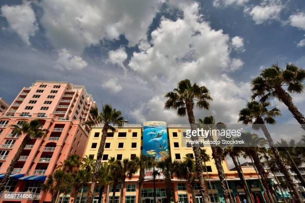 clearwater beach strip with palm trees and building building structures - clearwater beach stock pictures, royalty-free photos & images