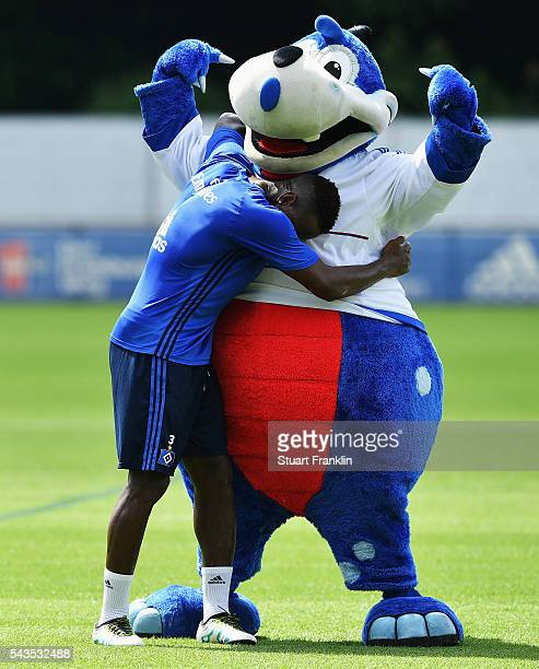Cleber Reis hugs the club mascot Hermann during the first training session of Hamburger SV after the summer break on June 29 2016 in Hamburg Germany
