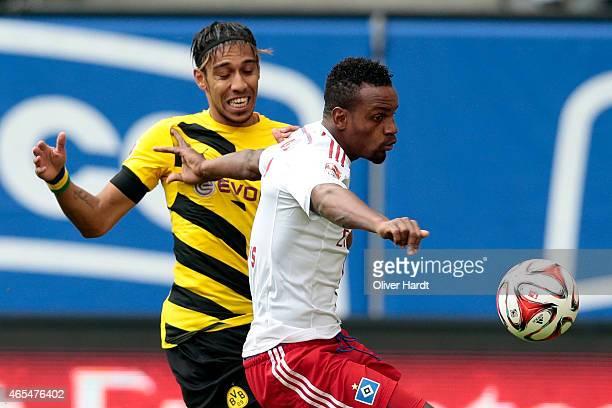 Cleber Reis of Hamburg and Patrick Emerick Aubameyang of Dortmund compete during the First Bundesliga match between Hamburger SV and Borussia...
