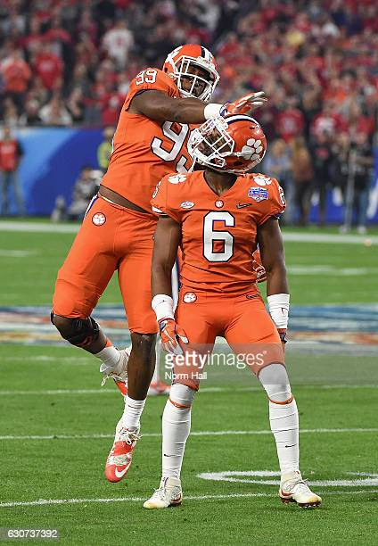 Clelin Ferrell of the Clemson Tigers and Dorian O'Daniel of the Clemson Tigers react during the first half of the 2016 PlayStation Fiesta Bowl...