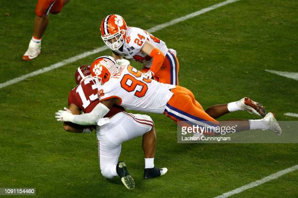 Clelin Ferrell of the Clemson Tigers tackles Tua Tagovailoa of the Alabama Crimson Tide on fourth down during the fourth quarter in the College...