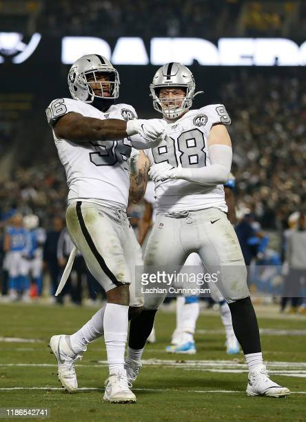 Clelin Ferrell of the Oakland Raiders celebrates with Maxx Crosby after sacking quarterback Philip Rivers of the Los Angeles Chargers at RingCentral...