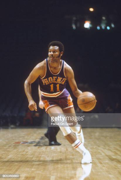 Clem Haskens of the Phoenix Suns dribbles the ball against the Capital Bullets during an NBA basketball game circa 1974 at the Capital Centre in...