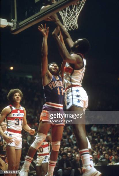 Clem Haskens of the Phoenix Suns has his shot blocked by Elvin Hayes of the Capital Bullets during an NBA basketball game circa 1992 at the Capital...