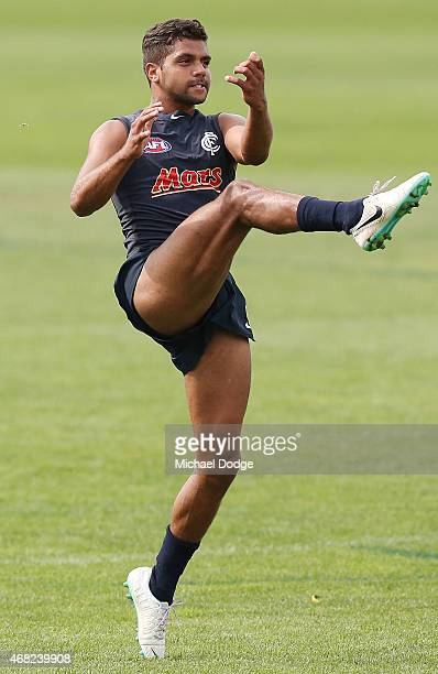 Clem Smith kicks the ball during a Carlton Blues AFL training session at Ikon Park on April 1 2015 in Melbourne Australia