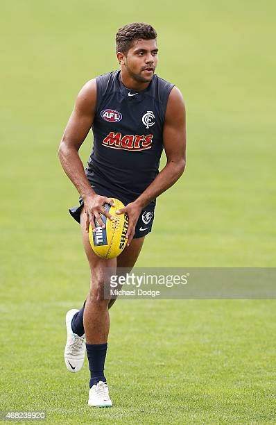 Clem Smith runs with the ball during a Carlton Blues AFL training session at Ikon Park on April 1 2015 in Melbourne Australia
