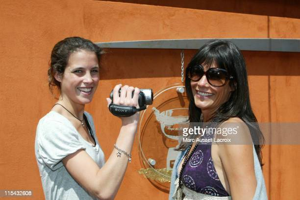Clemence Castel winner of Koh Lanta and Astrid Veillon arrives in the 'Village' the VIP area of the French Open at Roland Garros arena in Paris...