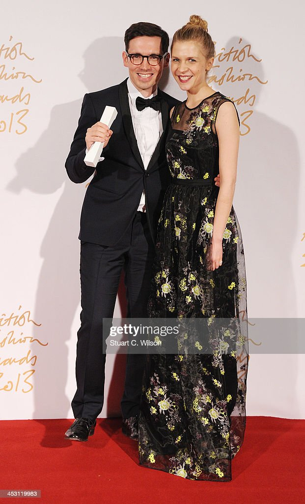 Clemence Poesy and Erdem Moralioglu with the Red Carpet Designer of the Year Award (L) pose in the winners room at the British Fashion Awards 2013 at London Coliseum on December 2, 2013 in London, England.