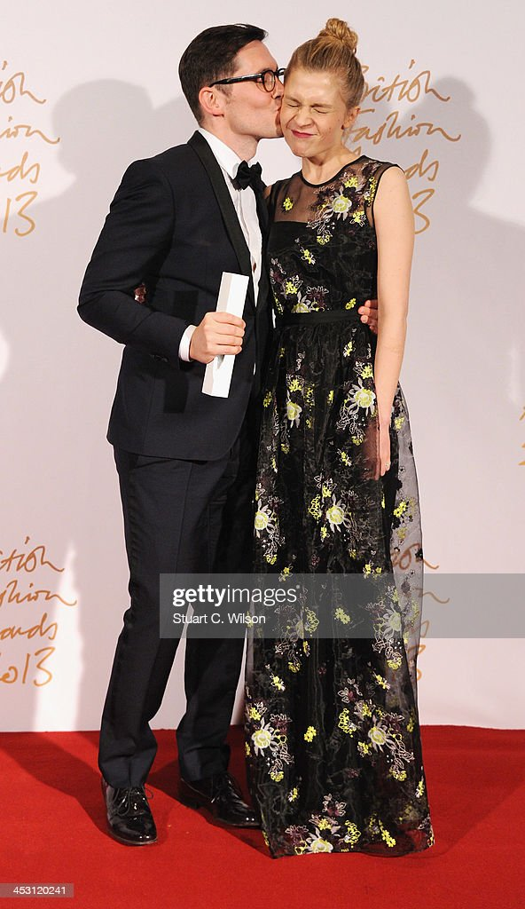 Clemence Poesy (R) and Erdem Moralioglu with the Red Carpet Designer of the Year Award poses in the winners room at the British Fashion Awards 2013 at London Coliseum on December 2, 2013 in London, England.