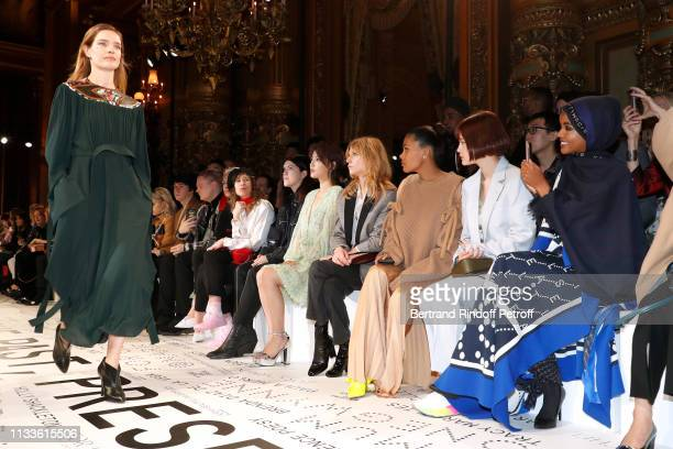 Clemence Poesy, Tina Kunakey, Emma and Halima Aden watches Natalia Vodianova walking the runway during the Stella McCartney show as part of the Paris...