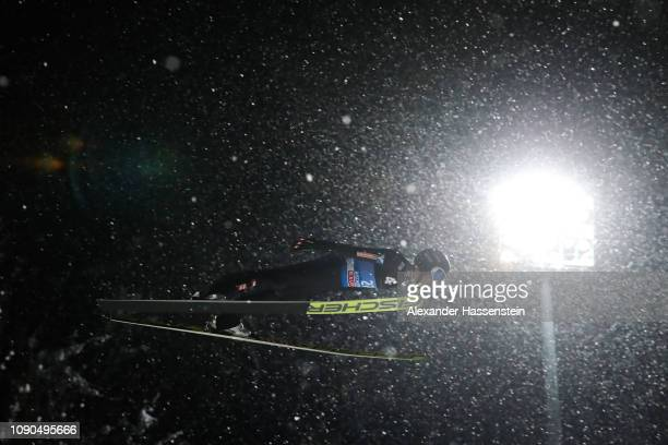 Clemens Aigner of Austria competes during the qualification round on day 8 of the 67th FIS Nordic World Cup Four Hills Tournament ski jumping event...