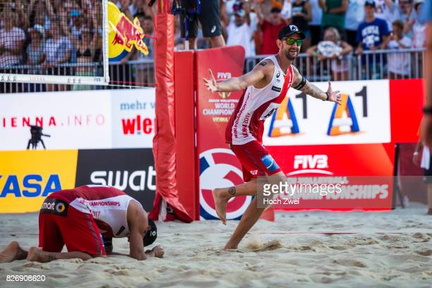 Clemens Doppler and Alexander Horst of Austria celebrate during Day 9 of the FIVB Beach Volleyball World Championships 2017 on August 5 2017 in...