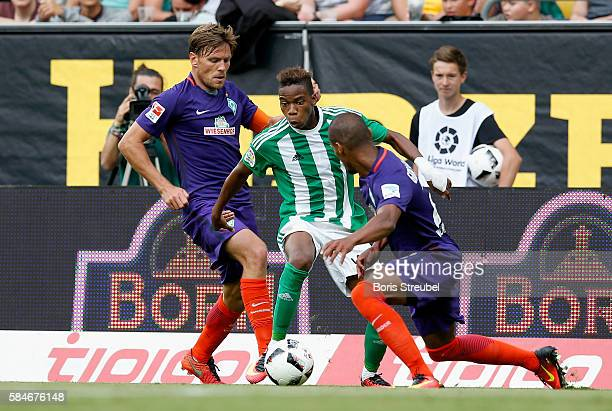 Clemens Fritz and Theodor Gebre Selassie of Werder Bremen challenge Charly Musonda of Real Betis during the Bundeswehr Karriere Cup Dresden 2016...