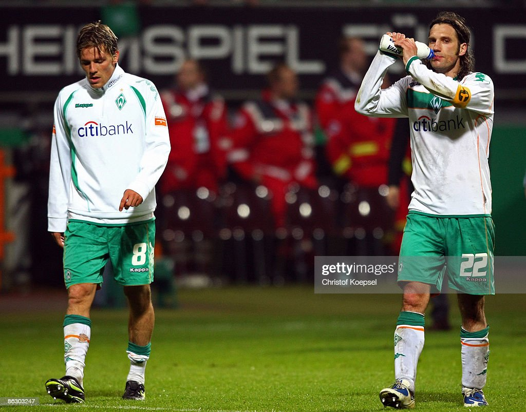 Clemens Fritz and Torsten Frings of Bremen look dejected after losing 0-1 the UEFA Cup Semi Final first leg match between SV Werder Bremen and Hamburger SV at the Weser stadium on April 30, 2009 in Bremen, Germany.