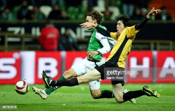 Clemens Fritz of Bremen and Felipe Lopes of Funchal compete for the ball during the UEFA Europa League Group L match between Werder Bremen and CD...