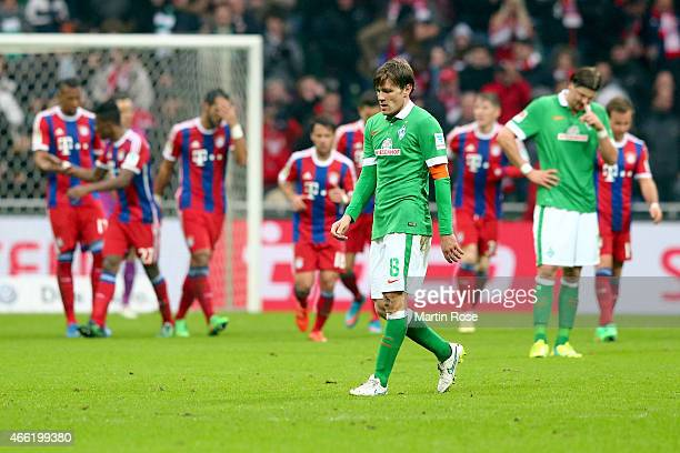 Clemens Fritz of Bremen and his team mate Sebastian Proedl reacts during the Bundesliga match between SV Werder Bremen and FC Bayern Muenchen at...