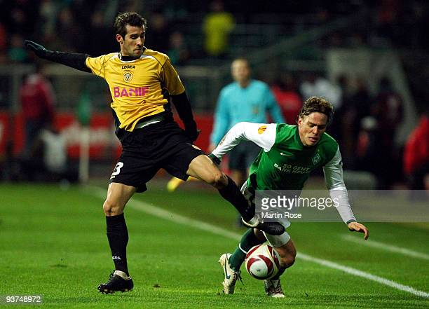 Clemens Fritz of Bremen and Joao Aurelio of Funchal compete for the ball during the UEFA Europa League Group L match between Werder Bremen and CD...