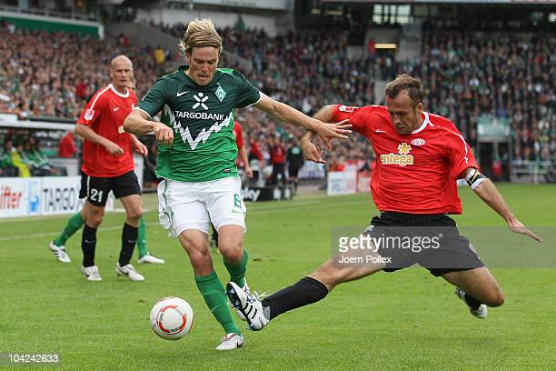 Clemens Fritz of Bremen and Nikolce Noveski of Mainz battle for the ball during the Bundesliga match between Werder Bremen and FSV Mainz 05 at the...