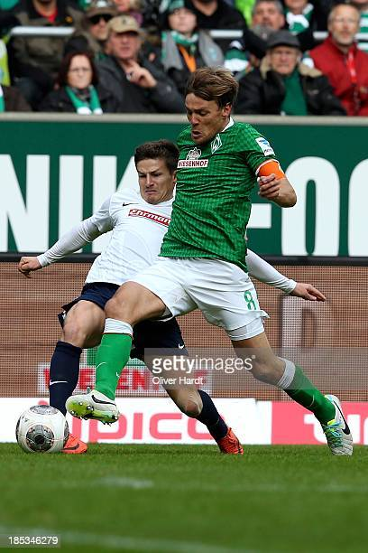 Clemens Fritz of Bremen and Vaclav Pilar of Freiburg compete for the ball during the First Bundesliga match between SV Werder Bremen and SC Freiburg...