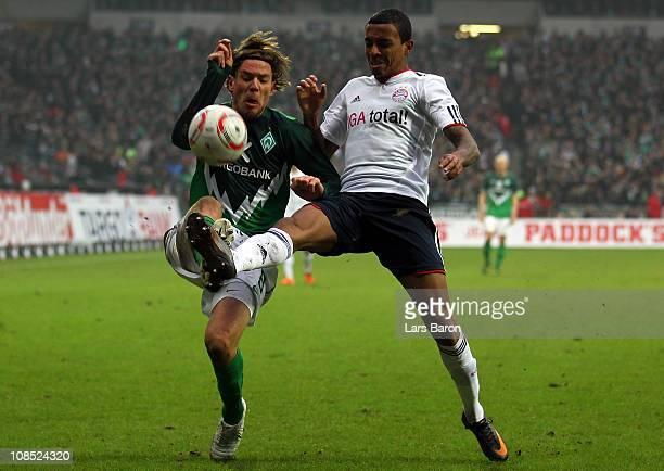 Clemens Fritz of Bremen challenges Luiz Gustavo of Muenchen during the Bundesliga match between SV Werder Bremen and FC Bayern Muenchen at Weser...