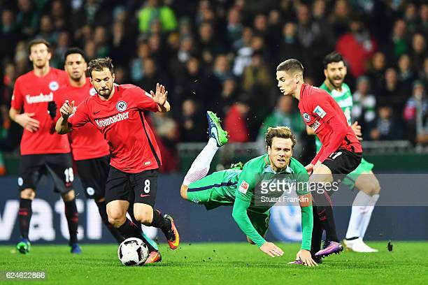 Clemens Fritz of Bremen is challenged by Mijat Gacinovic of Frankfurt during the Bundesliga match between Werder Bremen and Eintracht Frankfurt at...