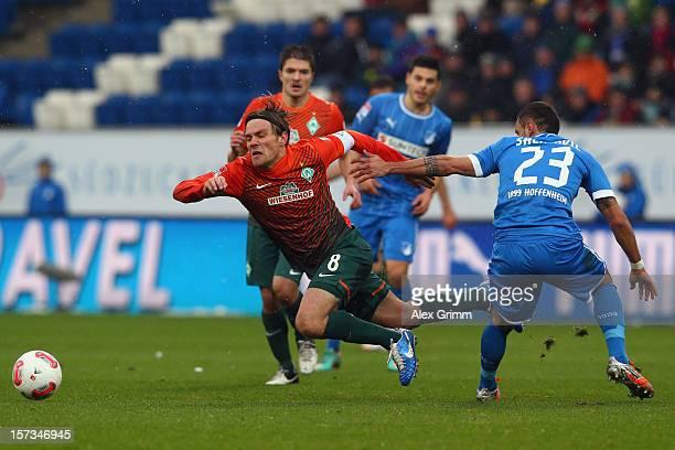 Clemens Fritz of Bremen is challenged by Sejad Salihovic of Hoffenheim during the Bundesliga match between TSG 1899 Hoffenheim and SV Werder Bremen...
