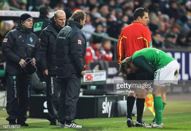 Clemens Fritz of Bremen is seen injured during the Bundesliga match between SV Werder Bremen and FC St Pauli at Weser Stadium on November 28 2010 in...