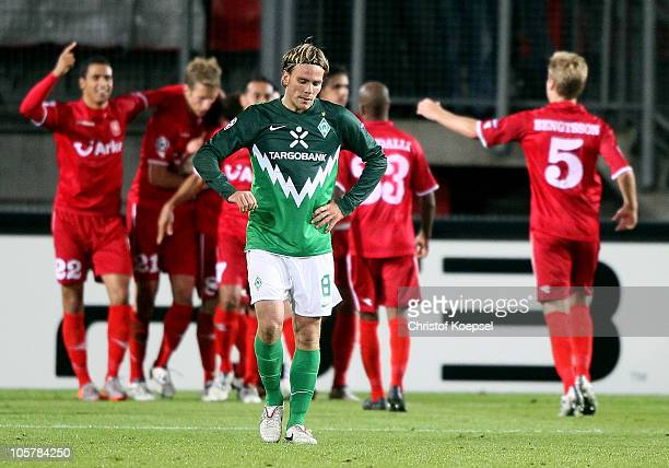 Clemens Fritz of Bremen looks dejected afte the first goal of Enschede during the UEFA Champions League group A match between FC Twente and SV Werder...