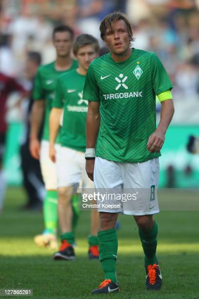 Clemens Fritz of Bremen looks dejected after losing 2-3 the Bundesliga match between Hanover 96 and SV Werder Bremen at AWD Arena on October 2, 2011...