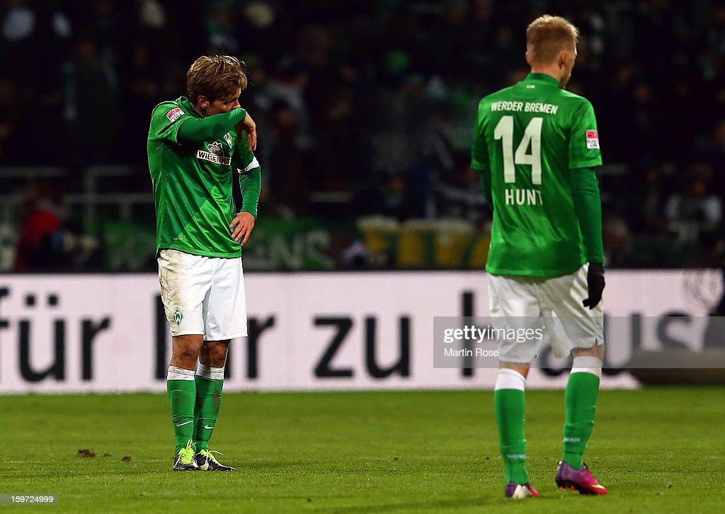 Clemens Fritz (L) of Bremen looks dejected after the Bundesliga match between Werder Bremen and Borussia Dortmund at Weser Stadium on January 19, 2013 in Bremen, Germany.