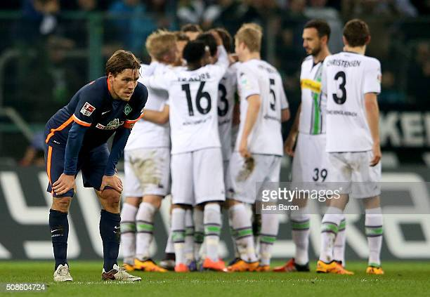Clemens Fritz of Bremen looks dejected during the Bundesliga match between Borussia Moenchengladbach and Werder Bremen at BorussiaPark on February 5...
