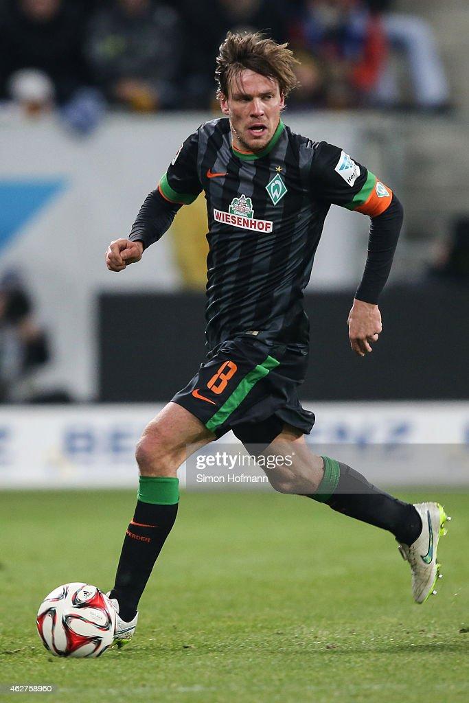 Clemens Fritz of Bremen runs with the ball during the Bundesliga match between TSG 1899 Hoffenheim and SV Werder Bremen at Wirsol Rhein-Neckar-Arena on February 4, 2015 in Sinsheim, Germany.
