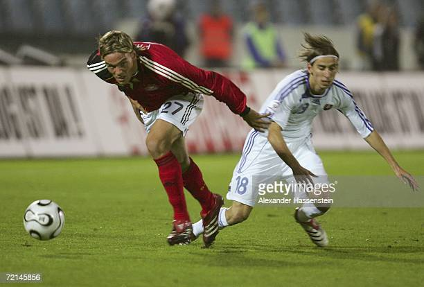 Clemens Fritz of Germany challenges for the ball with Dusan Svento of Slovakia during the UEFA Euro2008 qualifier between Slovakia and Germany at the...
