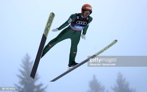 Clemens Leitner of Austria soars through the air during his practice jump of the FIS Nordic World Cup Four Hills Tournament on January 6 2018 in...