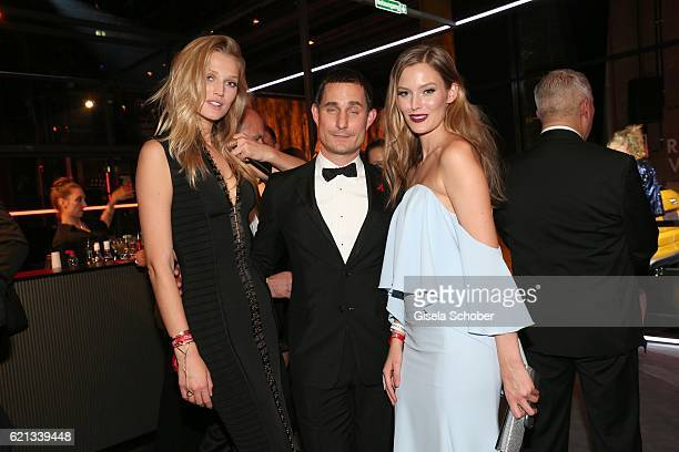Clemens Schick Toni Garrn and Charlott Cordes during the aftershow party of the 23rd Opera Gala at Deutsche Oper Berlin on November 5 2016 in Berlin...