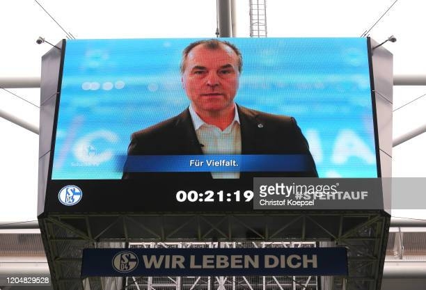Clemens Toennies, Chairman of FC Schalke 04 is seen speaking on the big screen as part of the anti-racism campaign, #Stehtauf prior to the Bundesliga...