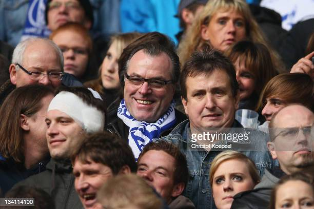 Clemens Toennies chairman of the supervisory board of Schalke stands with the fans on the tribune during the Bundesliga match between Borussia...