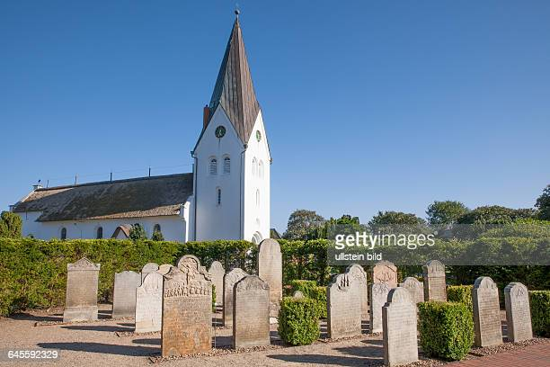 ClemensKirche im Ort Nebel Nordsee SchleswigHolstein St Clemenschurch with gravestones of seafarers and captains in the village Nebel on the island...