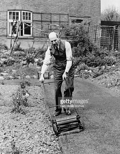 Clement Attlee Labour politician 19 April 1945 Attlee Britain's deputy prime minister at the time cutting the lawn at his home in Stanmore Essex...