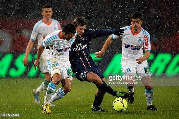 Clement Chantome of PSG and Jeremy Morel of Marseille battle for the ball during the Ligue 1 match between Paris SaintGermain FC and Olympique de...