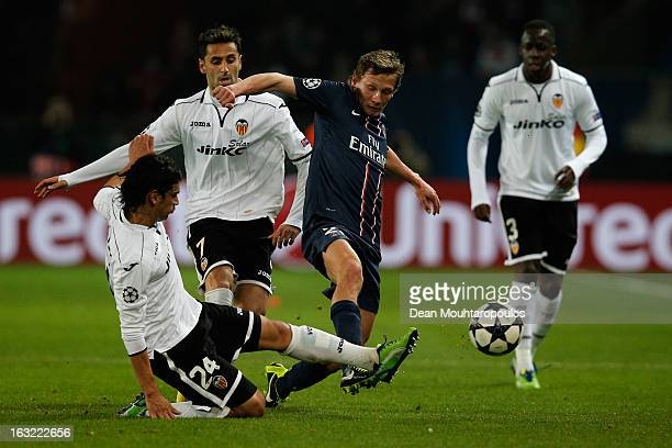 Clement Chantome of PSG and Tino Costa of Valencia battle for the ball during the Round of 16 UEFA Champions League match between Paris St Germain...