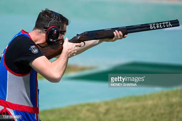 Clement Francis Andre Bourgue of France competes in the shotgun mens trap event during the ISSF World Cup 2021 at the Karni Singh shooting range in...