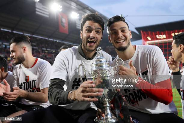 Clement Grenier and Rami Bensebaini of Rennes celebrate with their fans after winning the French Cup trophy during the Ligue 1 match between Rennes...